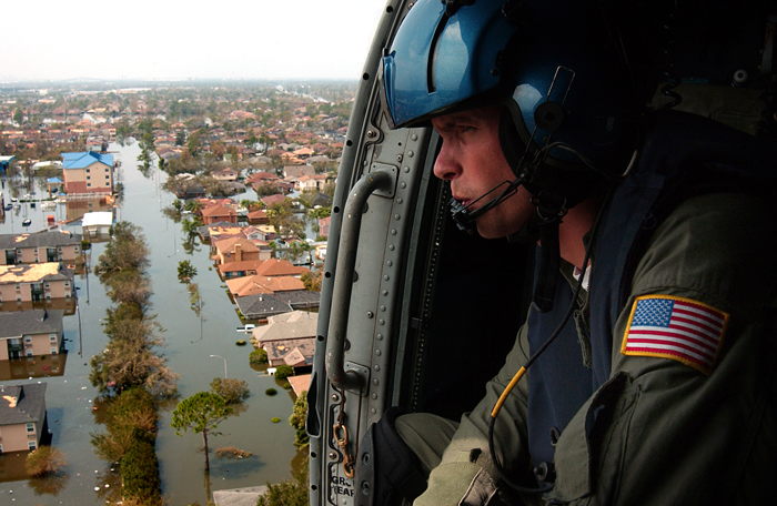 Helicopter flies over Hurricane Katrina devastation.
