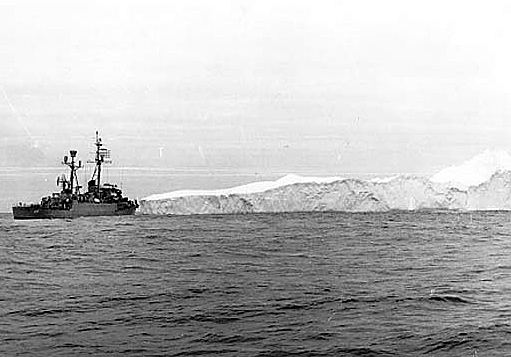 A picket ship near an iceberg.
