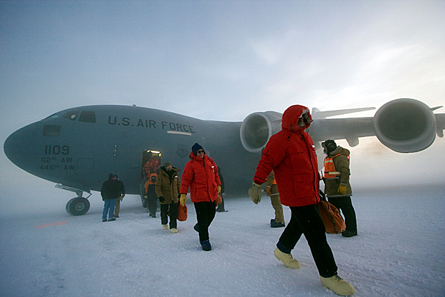 Passengers disembark from a C-17.