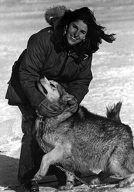 Elena Marty with a husky dog.