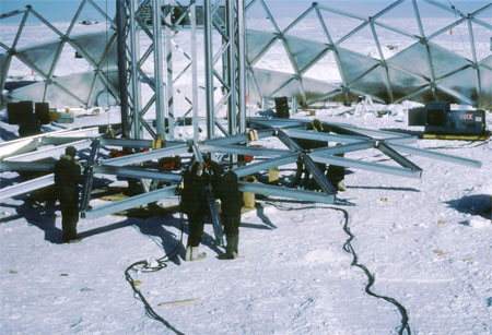 People work on the dome.