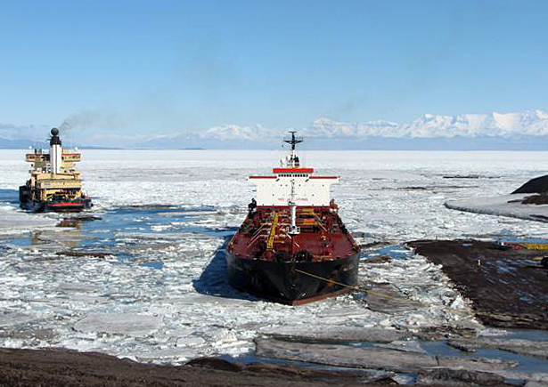 Two ships in ice-choked sea.