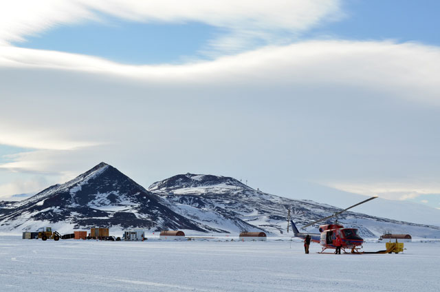 Helicopter sits on ice.