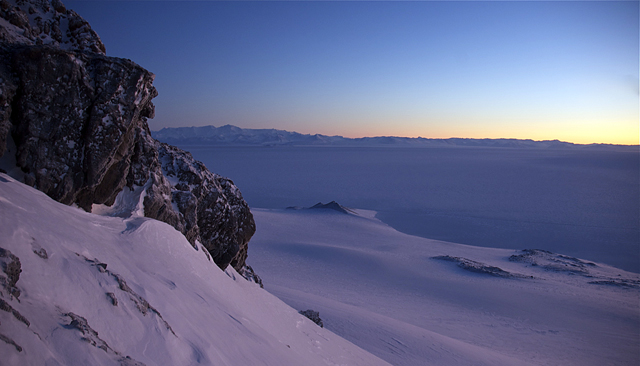 Twilight glow on snow and rocks.