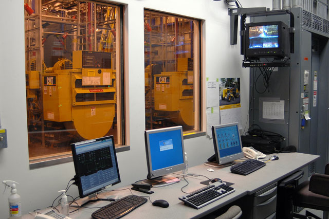 Computers with engines in background.