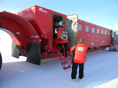 Newly arrived passengers getting on a transport vehicle to be taken from the Ice Runway to McMurdo Station