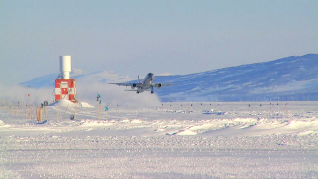 Plane lifts off from ice runway.