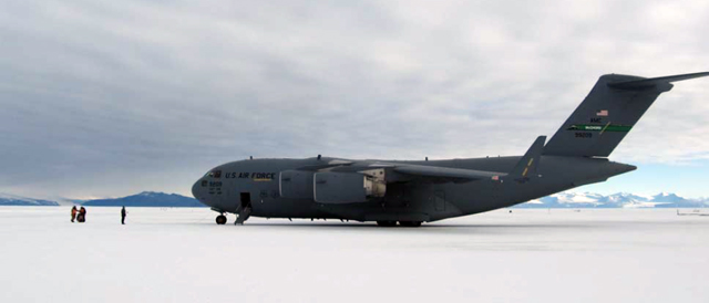 Large airplane sits on ice.