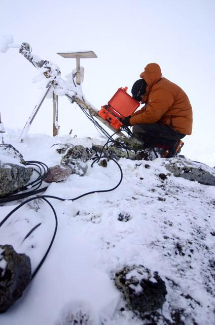 Person works on instrument in cold weather.