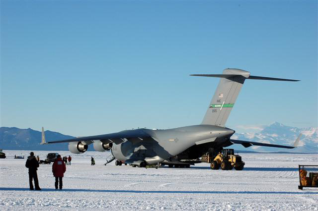 Large plane sits on ice field.