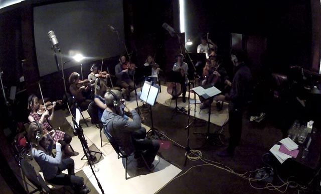 Musicians play in a studio.