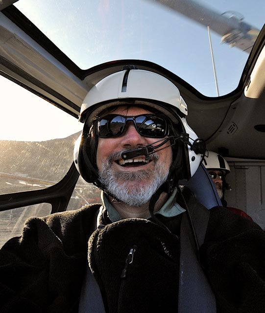 Person in a helicopter cockpit.