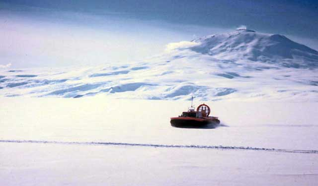 A hovercraft glides across ice.