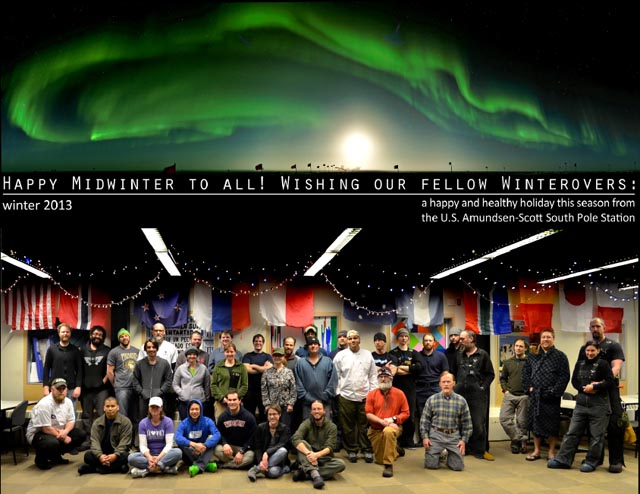Group of people with photo or aurora above.