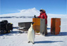 Jessica Meir works with an emperor penguin at a site known as Penguin Ranch near McMurdo Station in 2008.