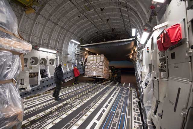Cargo is removed from inside a plane.