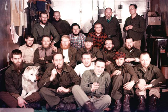 Group photo of men with a dog.
