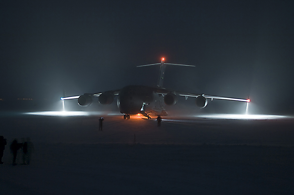 A plane at night.