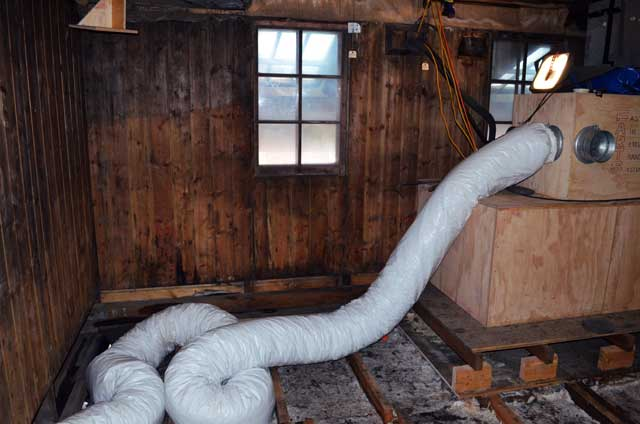 Big tube sits in a wood building.