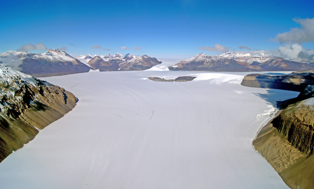 Aerial view of glacier in mountains.