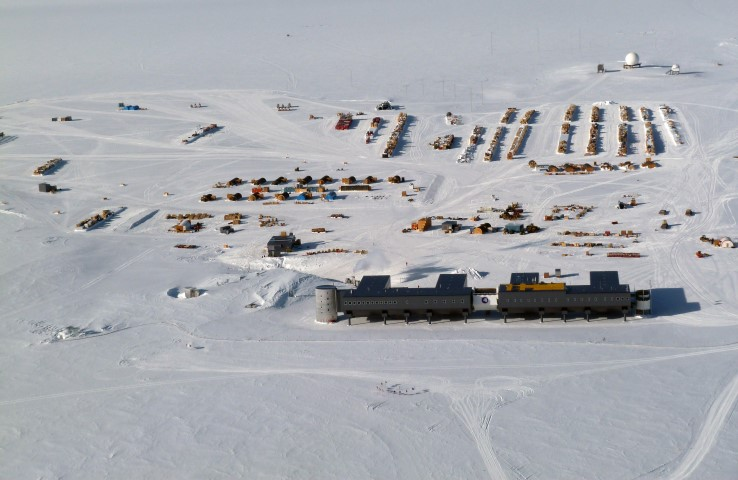 Aerial view of buildings on snow.