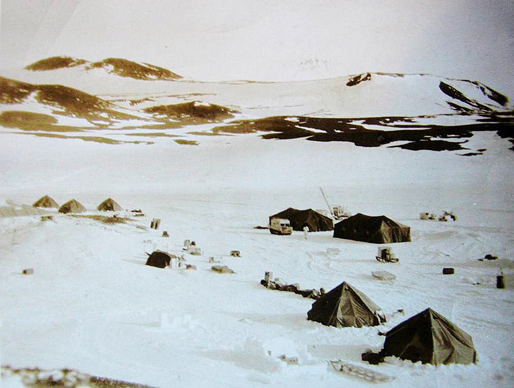Old photo of tents on snow.
