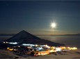 The moon shines over McMurdo Station in June 2014, when the winter hits the midpoint on the 21st.