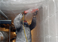 Carpenter Patrick Bailey uses a chainsaw to cut blocks of ice out of a tunnel below the South Pole Station.