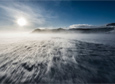 A ground blizzard sweeps across the ice shelf that leads to Ross Island, where McMurdo Station and New Zealand's Scott Base are located