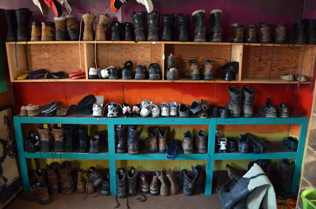 A shelf full of shoes.