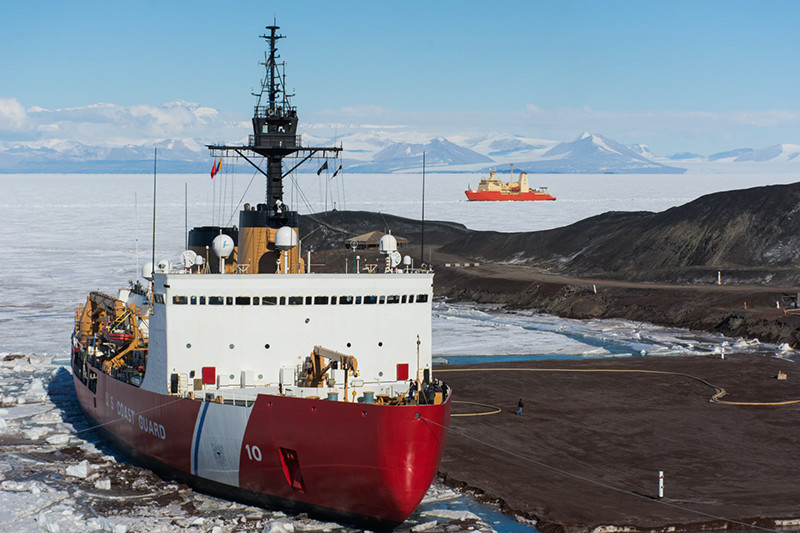 The Icebreaker USCGC Polar Star sits docked at McMurdos ice pier