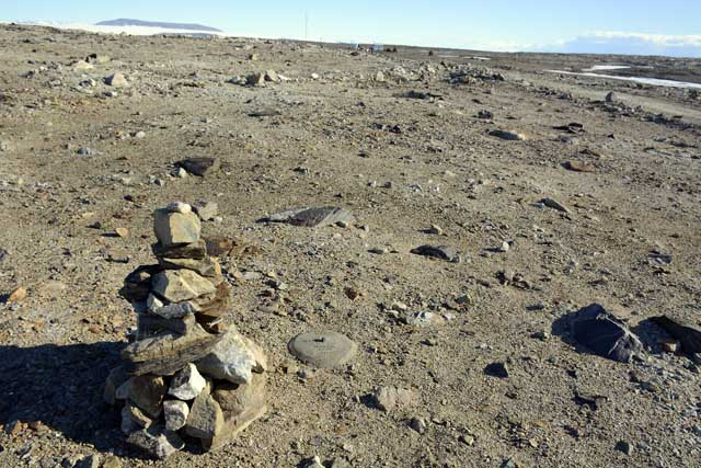Rock cairn near a marker.