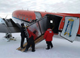 The SuperTIGER recovery team loads a section of the instrument onto an airplane.