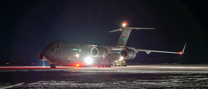 An Air Force C-17 at Pegasus Airfield in the darkness of an Antarctic June.