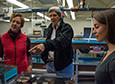 Scientist Amy Moran of the University of Hawaii at Monoa (left) tells Secretary of State John Kerry about her research