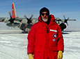 Charles Bentley stands in front of an LC-130 after arriving at the West Antarctic Ice Sheet drilling camp, known popularly as WAIS Divide, in January 2008.