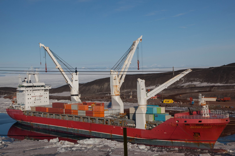 The cargo vessel USNS Ocean Giant unloads supplies at McMurdo Stations ice pier