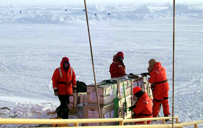 Scientists on ice floe.