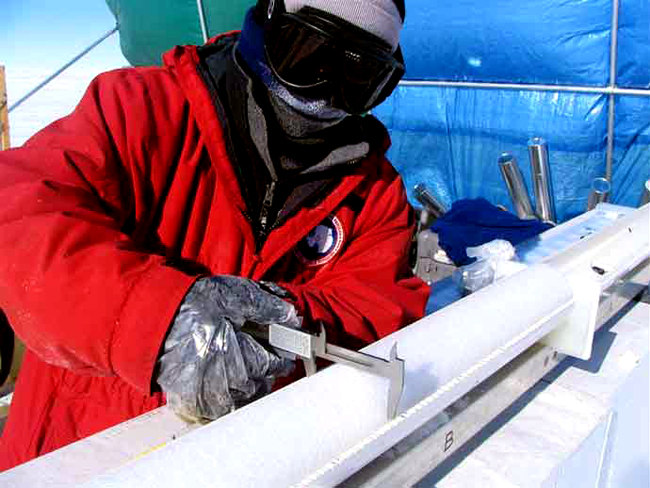 Scientist Dan Dixon measures an ice core.
