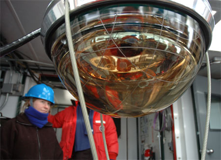 Spherical instrument with woman in background.