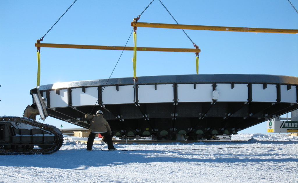 SPT dish lifted by cranes.