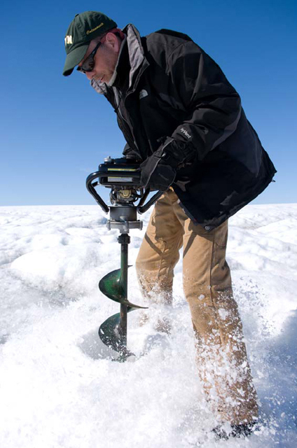Ian Joughin drills a hole in the Greenland ice sheet.