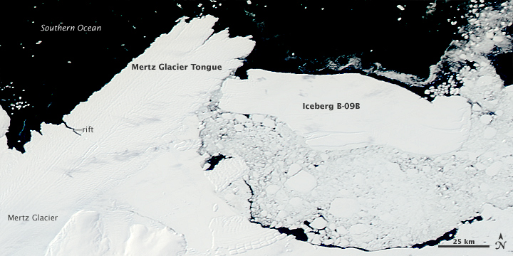 Iceberg collides with glacier tongue.
