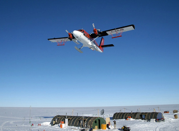 Twin Otter flies over field camp.