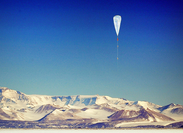 Large balloon floats above ice.
