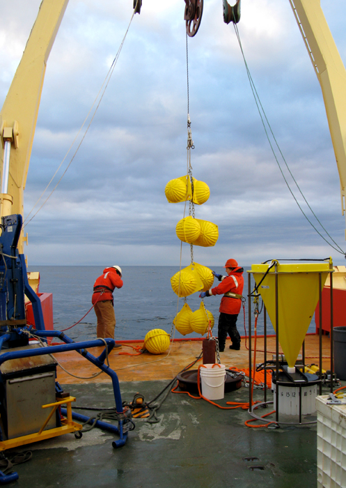 Scientists deploy sediment traps from a ship.