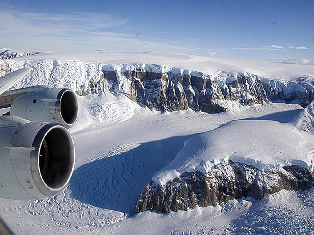 Valley full of snow with airplane engine.
