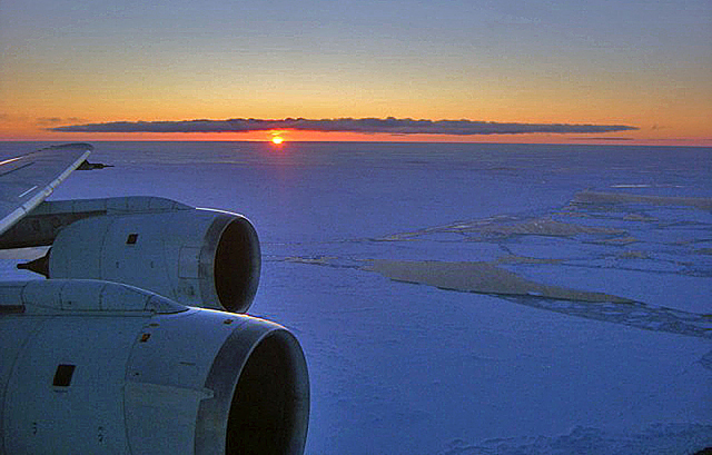 Wing of plane and ice horizon.