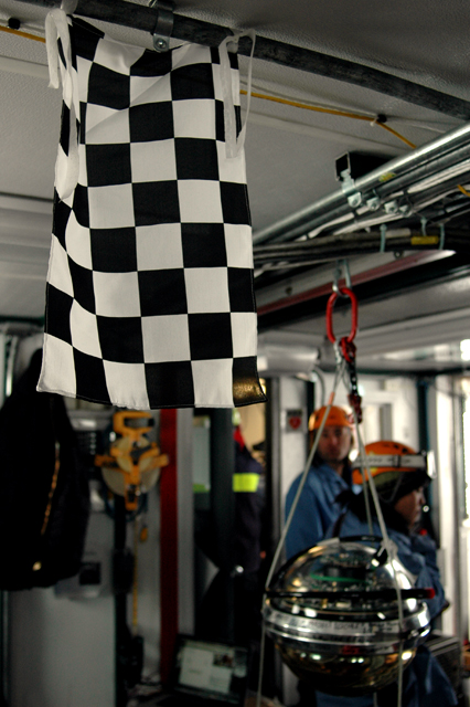 Checkered flag hangs in a room.