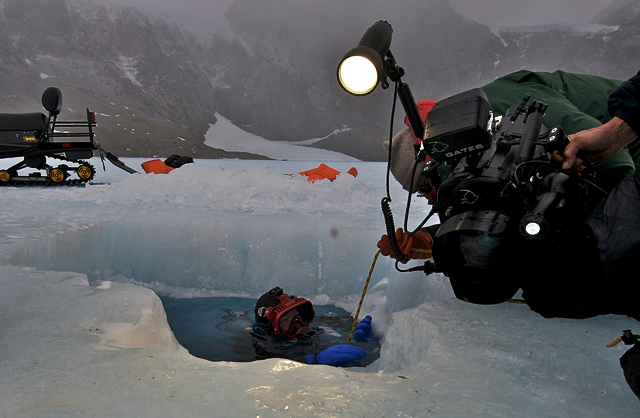 Dale Andersen prepares to dive in Antarctic lake.